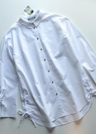 Стильная белая блуза рубашка со шнуровкой