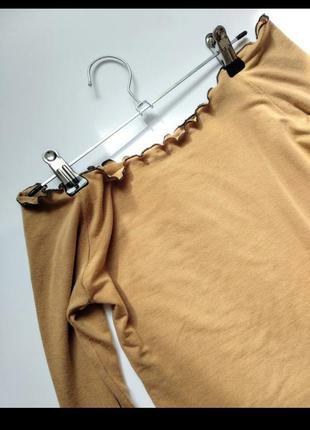 Трикотажная кофточка с открытыми плечами