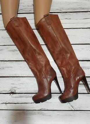 Сапоги ботфорты высокие кожаные на платформе с высоким каблуко...