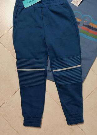 Спортивные штаны на мальчика со светоотражающими полосками