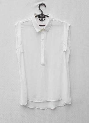 Белая нарядная блузка без рукавов