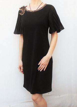 Черное трикотажное нарядное классическое платье