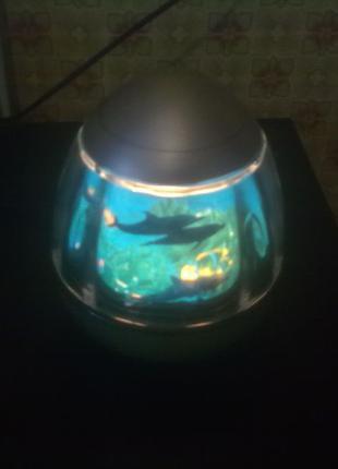 """Светильник - ночник детский вращающийся """"Стая дельфинов""""."""