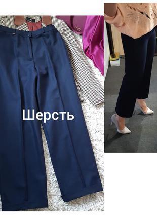 Актуальные стильные укороченные шерстяные брюки с подворотами,...