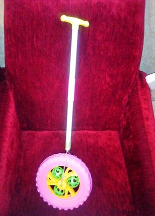 Игрушка.  Каталка колесо