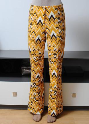 Стрейчевые брюки принтованые в стиое 70х