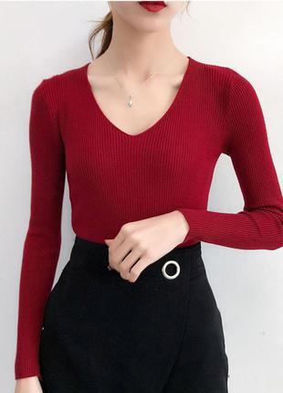 Трикотажный и чуть пушистый пуловер в рубчик бордовый или мара...