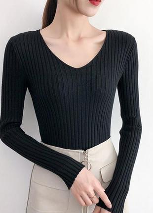 Трикотажный и чуть пушистый пуловер в рубчик черный ms