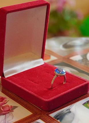 Серебряные 925 пробы серьги и кольцо с голубым цирконием