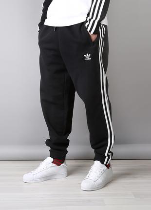 Теплые широкие спортивные штаны Адидас на флисе Зима AdidasМанжет