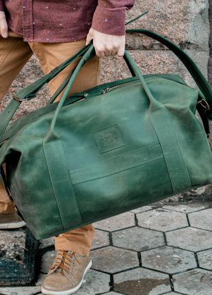 Вместительная кожаная дорожная сумка. Зеленая кожаная сумка