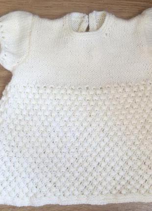 Симпатичная нарядная вязаная кофточка с коротким рукавом.
