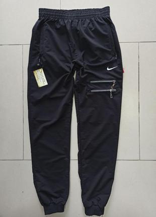 Стильные спортивные штаны с молниями на манжете