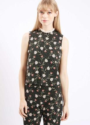 Блузка темно-зеленого цвета с оригинальным цветочным принтом t...
