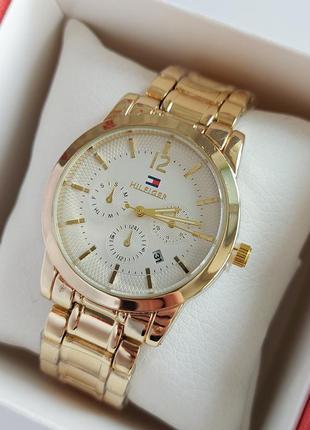 Женские наручные часы золотые с белым, дополнительные цифербла...