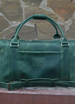 Дорожная кожаная сумка зеленого цвета. Спортивная сумка