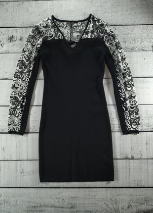 Платье трикотажное черное по фигуре с кружевом Yuka Paris