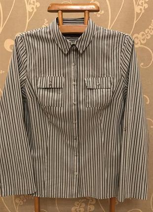 Очень красивая и стильная брендовая рубашка в полоску.