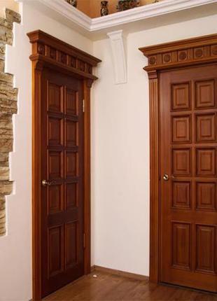 двери из дерева с резьбой