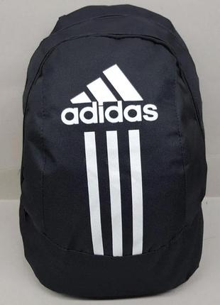 Новый рюкзак с модным логотипом.