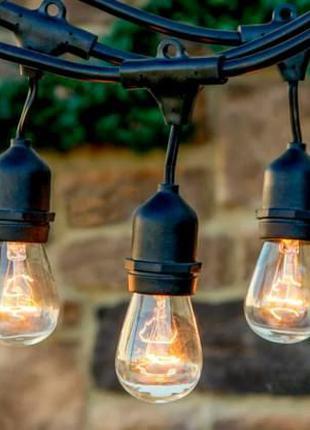 Фирменая гирлянда уличная под лампочку е27 водонепроницаемая а...