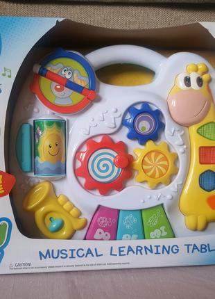 Детская музыкальная развивающая игрушка