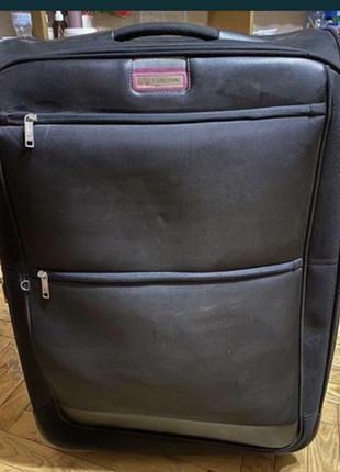 Продам оригинальный чемодан на кольосах carlton