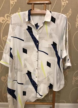 Нереально красивая и стильная брендовая блузка в абстракциях.