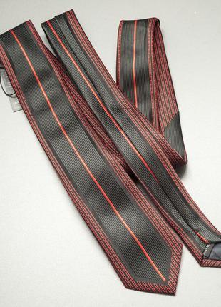 Галстук шелковый новый с биркой бордовый с черными полосками.