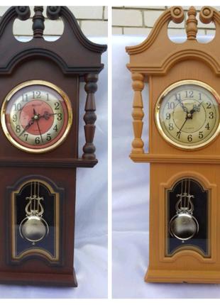 Часы настенные с маятником RIKON.
