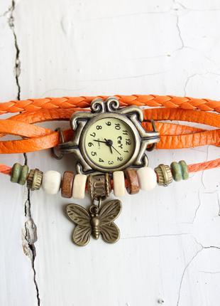 Женские часы-браслет оранжевого цвета с подвеской на батарейке