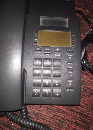 Телефоны кнопочный и дисковый