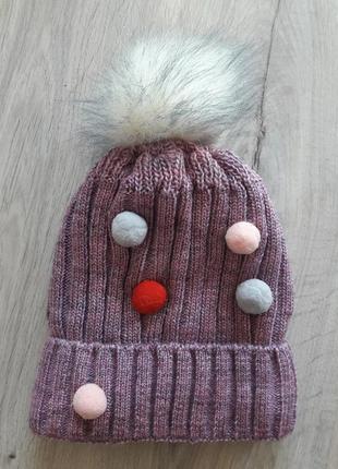 Вязаная,теплая, полушерстяная яркая сиреневая шапка с помпоном...