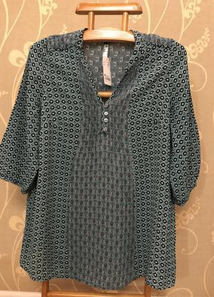 Очень красивая и стильная блузка..100% вискоза.