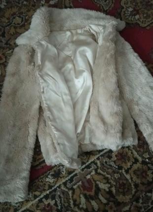 Меховая шубка с карманами