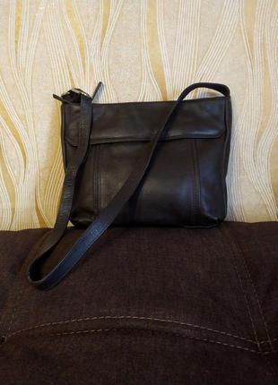 Коричневая кожаная сумка taurus