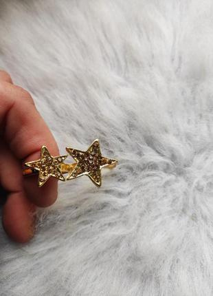 Золотистое двойное кольцо со стразами камнями золотыми звезда ...
