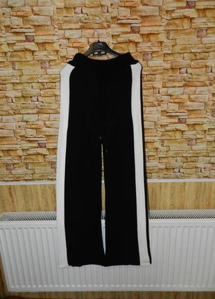 Крутые вязаные кюлоты брюки с лампасами