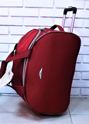 Дорожная сумка на колесах красная