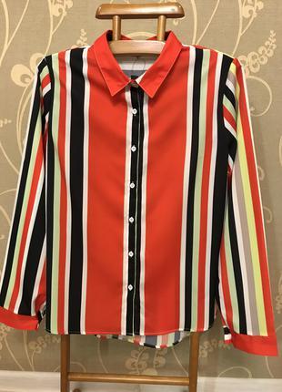 Очень красивая и стильная брендовая блузка в полоску.