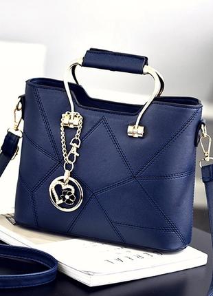 Женская синяя сумка с брелком