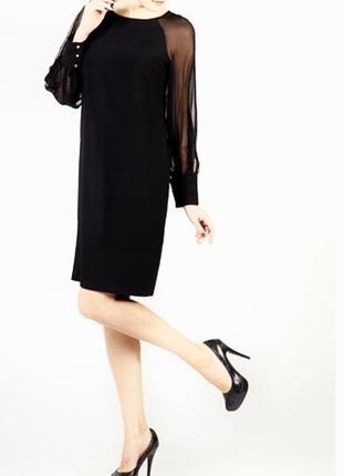 Черное стильное платье с прозрачными рукавами