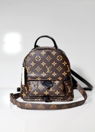 Женский рюкзак Louis Vuitton.
