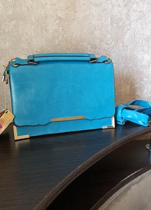 Женская голубая сумка-кейс из экокожи.
