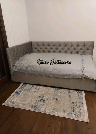 Кровать в каретной стяжке