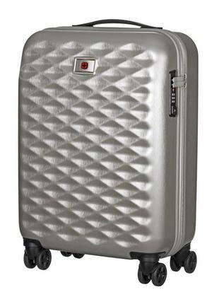 Пластиковый серебристый дорожный чемодан на колесах wegner lumen