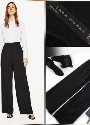 Фирменные, базовые, струящиеся брюки палаццо с завышенной тали...