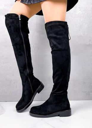 Черные зимние ботфорты на низком каблуке