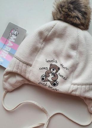 Тепла фирменная шапочка. шапки зима