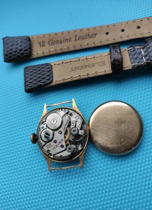 Золотые швейцарские часы Delbana 750 проба.